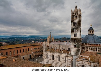View from above over Siena cathedral (Duomo di Siena) and the old town of Siena, Tuscany, Italy