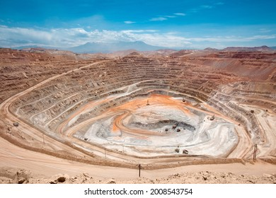 View from above of the pit of an open-pit copper mine in Peru