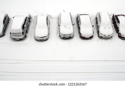 View from above to plenty of snow covered cars after snowfall parked in a yard