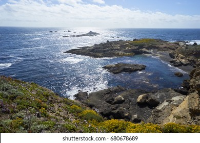 View from above a rocky cove westward into the horizon above the California Pacific