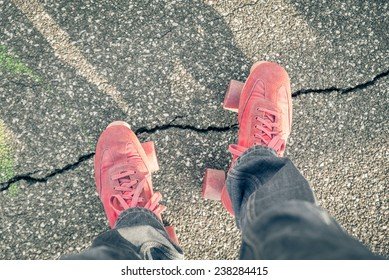 view above roller-skates boots with an asphalt background