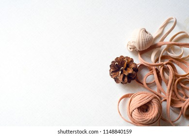 View from above of spruce cones and untangled tangle on table. Spruce cones and untangled tangle on the white desk. Spring day. Flat lay with copy space for text.