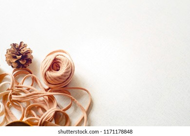 View from above of spruce cones and untangled tangle on table.Spruce cones and untangled tangle on the white desk. Spring day. Flat lay with copy space for text.