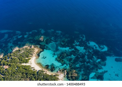 View from above, stunning aerial view of the Capriccioli Beach bathed by a beautiful turquoise sea. Costa Smeralda (Emerald Coast) Sardinia, Italy.