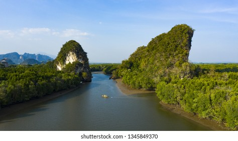 View from above, stunning aerial view of Khao Khanap Nam in Krabi town, Thailand. Khao Khanap Nam are two 100-meters tall limestone mountains jutting out of the Krabi River.