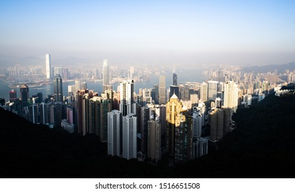 View from above, stunning view of the Hong Kong skyline during a beautiful sunset. Picture taken from the Victoria Peak. Victoria Peak is a hill on the western half of Hong Kong Island.