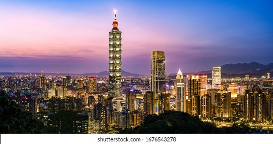View from above, stunning view of the Taipei City skyline illuminated at dusk during a beautiful sunset. Taipei officially Taipei City, is the capital and a special municipality of Taiwan.