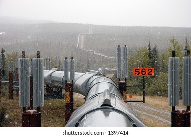 View above the trans-Alaska oil pipeline, during a July snow shower, showing the pipeline extending into the horizon
