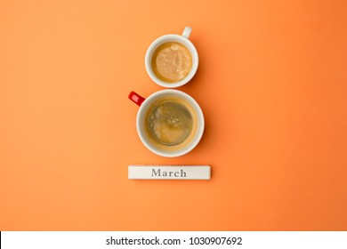 View from above with two cups of coffee copy space. Background for woman day, 8 March. Orange table. Woman and stilish workplace. 8 March and Women's Day concept.