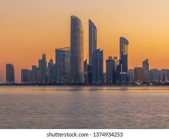 View of the Abu Dhabi Skyline from the Corniche during Sunrise. Abu Dhabi - UAE. 17 December 2018