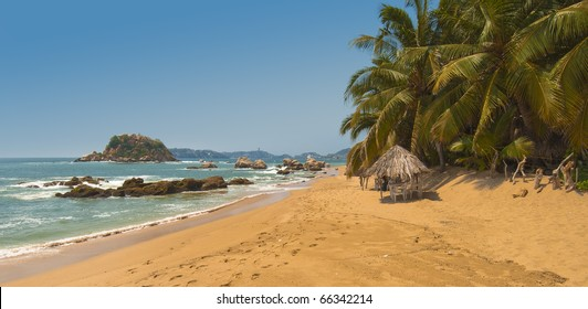 View of Acapulco Bay on a sunny day with beach cabanas