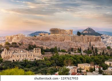 View to the Acropolis of Athens on top of the old town Plaka during a cloudy summer sunset, Greece