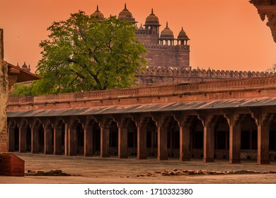 A view across the abandoned temple complex walls at Fathepur Sikri, India at sunset