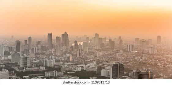 View across Bangkok skyline showing in sunset