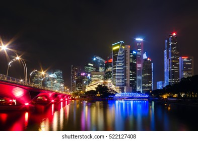 The view across the bay to the Singapore night bridge, skyscrapers and bright lights