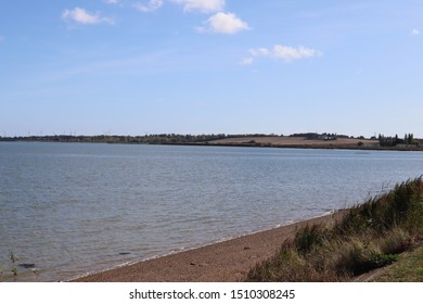 View across the bay from The Stone, St Lawrence, Steeple in Essex showing the windfarm on the opposite bank