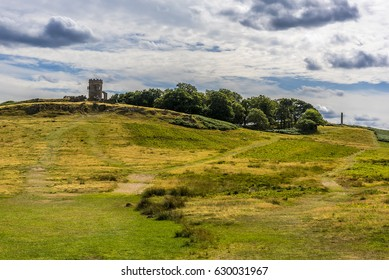 A view across Bradgate Park, Leicestershire, during the summer showing the Old John folly and the war memorial