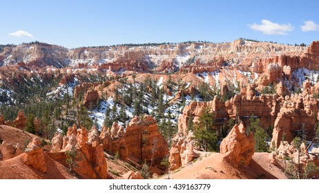 The view across Bryce Canyon, Utah, looking south from the path below Sunrise Viewpoint, with some snow remaining in Spring sunshine.