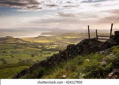 The view across Criccieth and the Lleyn Peninsula from Moel-y-Gest, a small mountain in Snowdonia National Park, Wales.