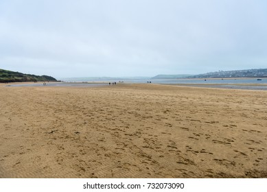 View across Daymer Bay in North Cornwall, on an autumnal day. Despite the mist and rain, this landscape attracts both locals and tourists throughout the year.