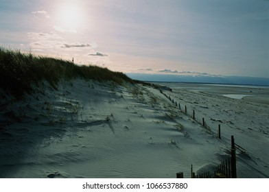 A view across the dunes at sunset -Mayflower Beach, Dennis, MA.