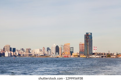 The view across the East River towards Hunter's Point South in Long Island City, New York City.  Roosevelt Island and Queensboro Bridge passing over the island can also be seen.