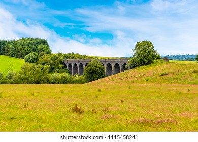 A view across the fields towards the old abandoned viaduct near Catesby, Warwickshire, UK