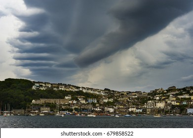 View across Fowey Harbour and into Polruan as the predicted storm rolls in from the sea.