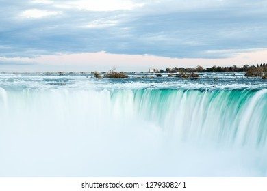 The view across the Horseshoe Falls at dusk, a part of the Niagara Falls, viewed from the Canadian side.  The falls straddle the border between America and Canada.