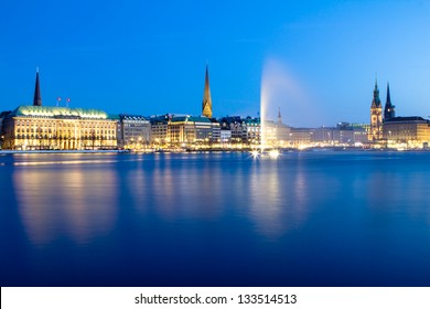 View across the Inner Alster Lake (Binnenalster) in Hamburg, Germany with the City Hall, the Nikolai and the Peter church