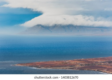 View across Isfjord in Svalbard, Blue water with boat and glaciers in the background, Svalbard, Spitsbergen, Norway