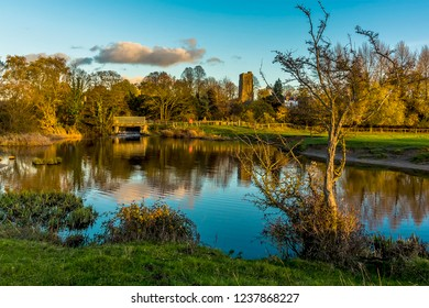 A view across a lake on the River Stour on the western edge of Sudbury, Suffolk