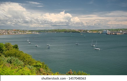 A view across Milford Haven to Neyland, the Cleddau Bridge and Pembroke Dock on a summer day with clouds