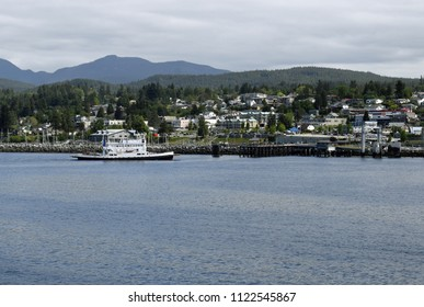 view across the ocean towards the harbour in  Powell River with the ferry arriving, British Columbia Canada