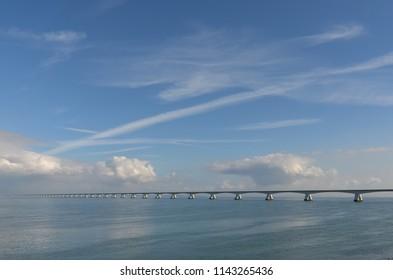 View across Oosterschelde estuary in the Netherlands towards Zeeland Bridge, longest bridge in the country