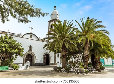 The view across the plaza of Las Palmas towards the Saint Gines Church in Arrecife, Lanzarote on a sunny afternoon