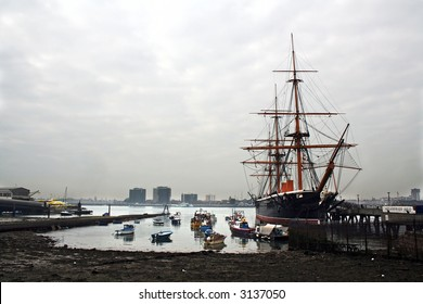 A view across Portsmouth harbour, with the preserved ironclad HMS Warrior on the right