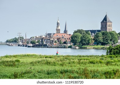 View across the river IJssel and its floodplain towards the old Hanze city of Kampen, The Netherlands
