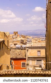 A view across the rooftops of a Sicilian town in Italy.