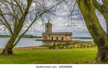 The view across Rutland Water in the UK from Normanton framed by two large trees