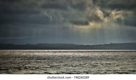 View across Solent to storm clouds over Isle of Wight, Hampshire UK