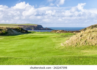 A View Across  St Enodoc Golf Course to the Sea and Coastline Beyond,  Cornwall, UK.