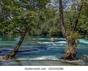 A view across the top of the Manavgat falls on the Manavgat river near Side, Turkey in summertime