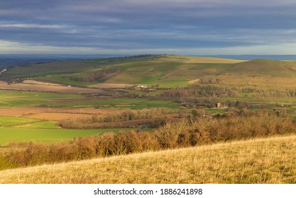 View across the valley to Mount Caburn and the Lewes Downs from Firle Beacon on the South Downs East Sussex south east England