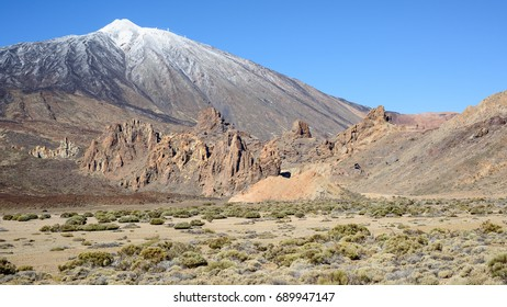 View across the volcanic landscape of the Teide National Park, Tenerife, in early Spring, with snow on the summit of Mount Teide.