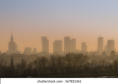 View across Warsaw skyline showing in sunset with smog and dust in the air, Low visibility caused by pollution problem in urban area, Big city in the fog, Fog and smog over Warsaw