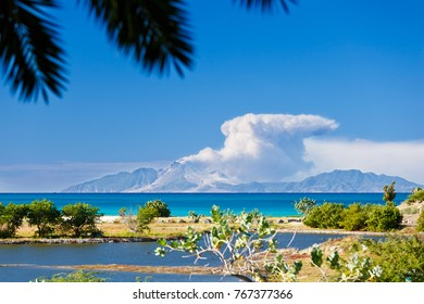 View to the active volcano in Montserrat with a large ash cloud.