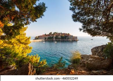 View in the Adriatic sea and Sveti Stefan at sunset. Milocer Park.  Coast Budva Riviera. Montenegro.
