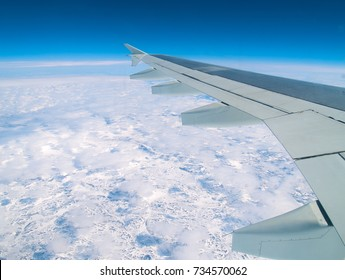View from aeroplane over arctic ice