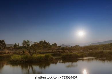 View to African lake with mountains. Lubango. Angola.